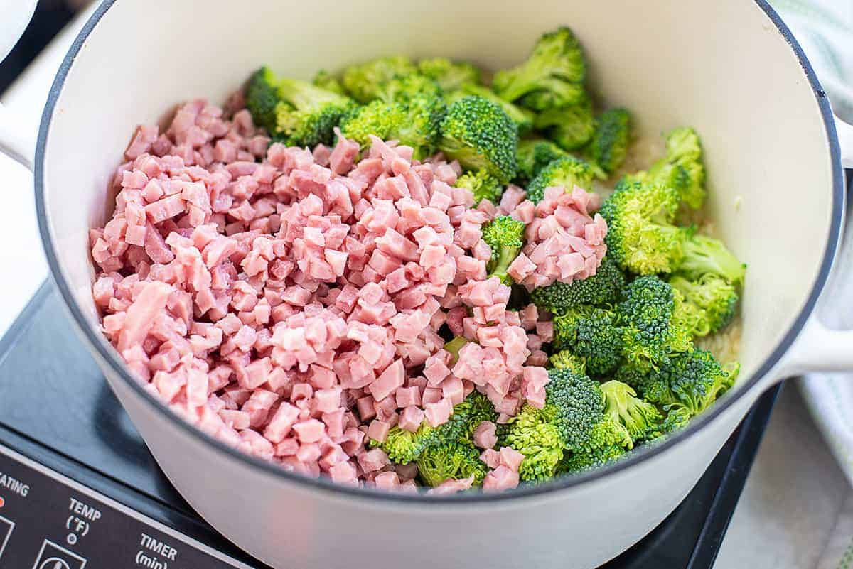 ham and broccoli in pot with rice.