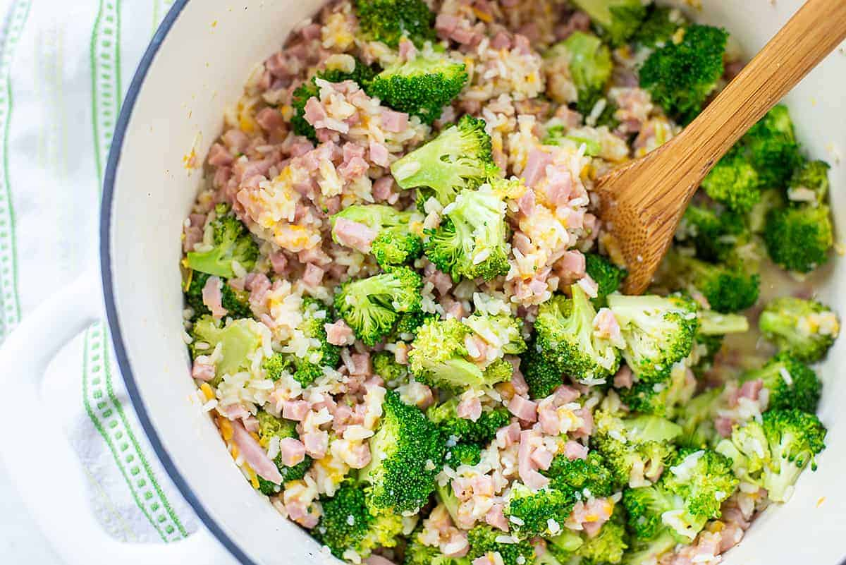 overhead view of rice and broccoli in pot.