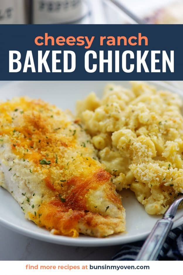 Ranch cheddar chicken on white plate next to mac and cheese.