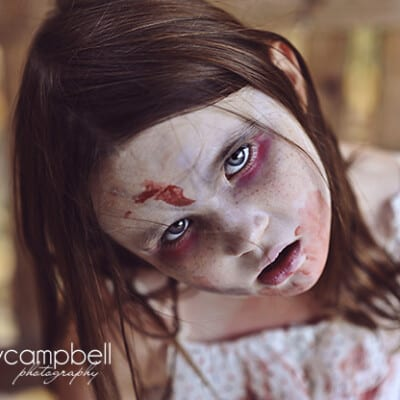 A close up of a girl dressed up as a zombie
