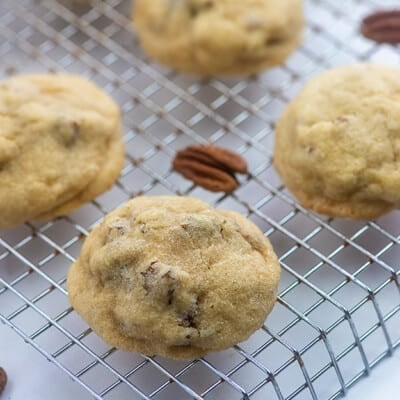 cookies and pecans on a cooling rack.