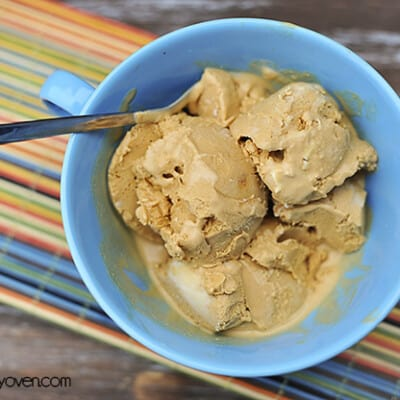 An overhead view of caramel ice cream in a bowl