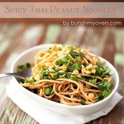 A bowl thai noodles on a table.