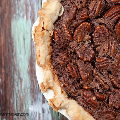 A close up of a chocolate pecan pie.