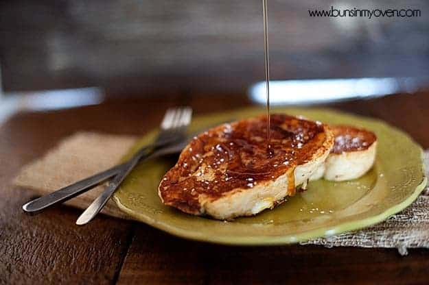 Syrup drizzled on top of a piece of french toast.