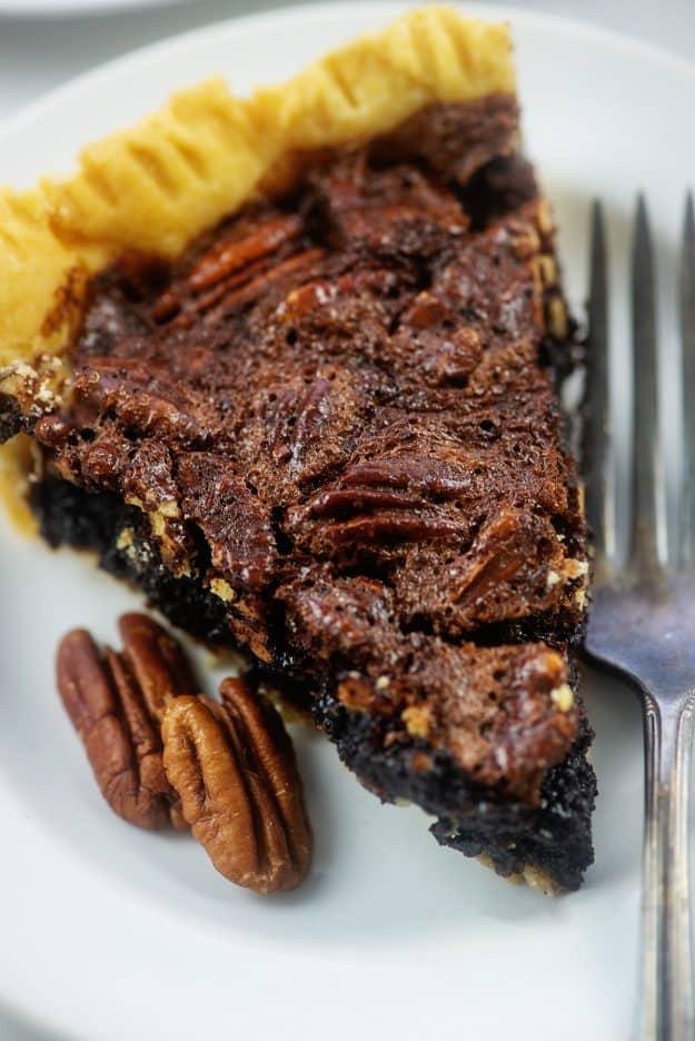 pecan pie on white plate.