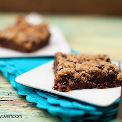A chocolate chip cookie bar on a folded blue napkin.