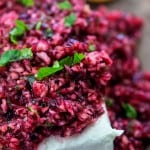 Cream cheese with processed cranberries on top.