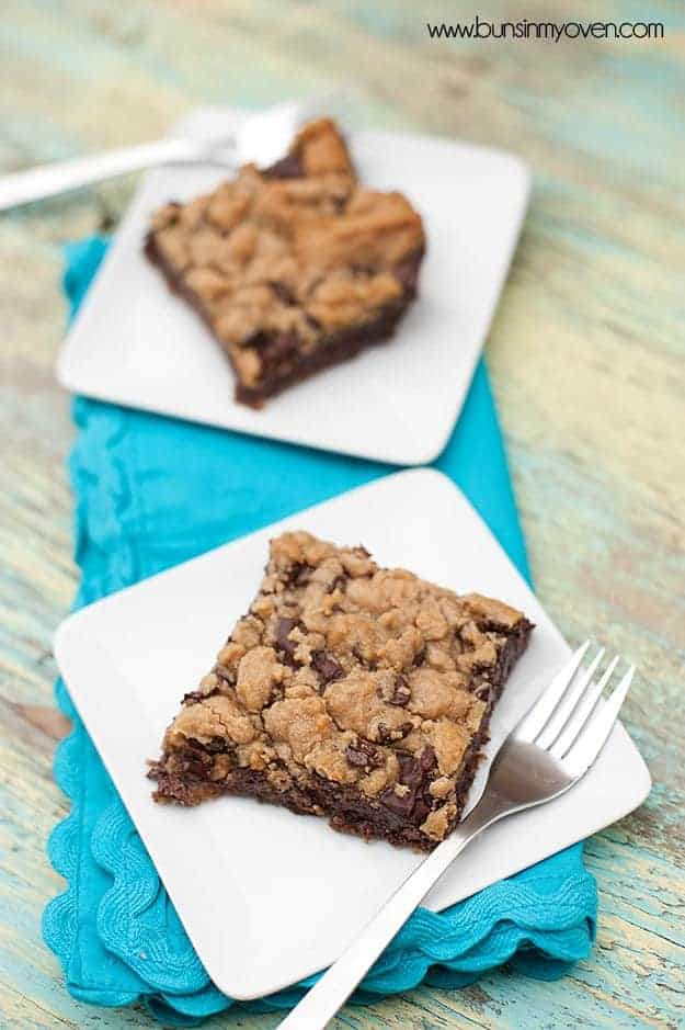 Two toffee cookie bars on separate white plates.