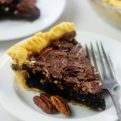 plates with pecan pie on top.