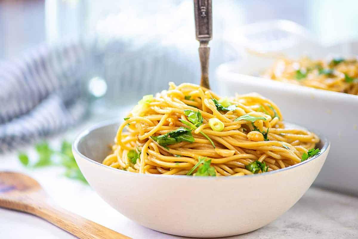 thai peanut noodle recipe in white bowl.