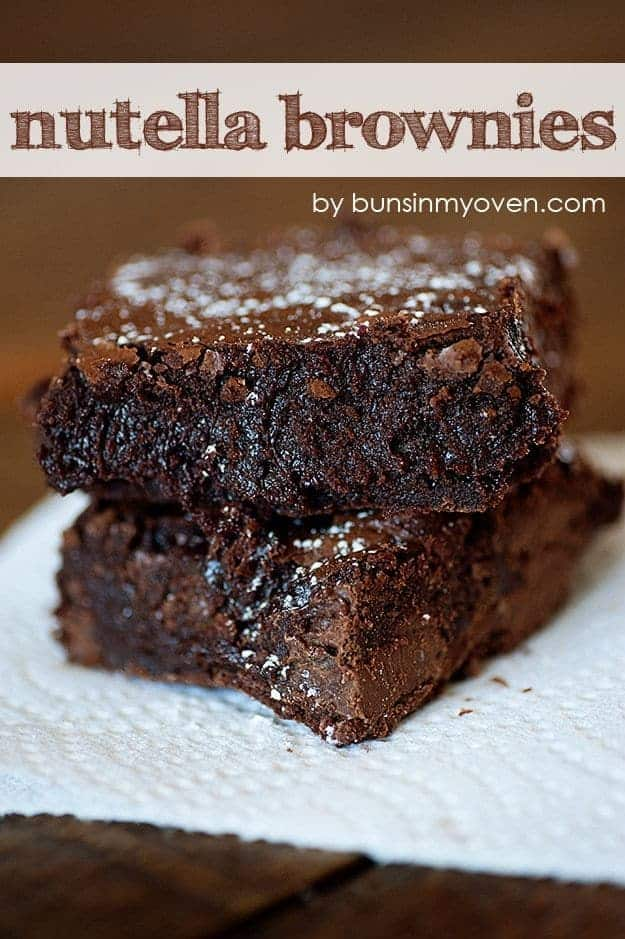 A close up of two stacked Nutella brownies.