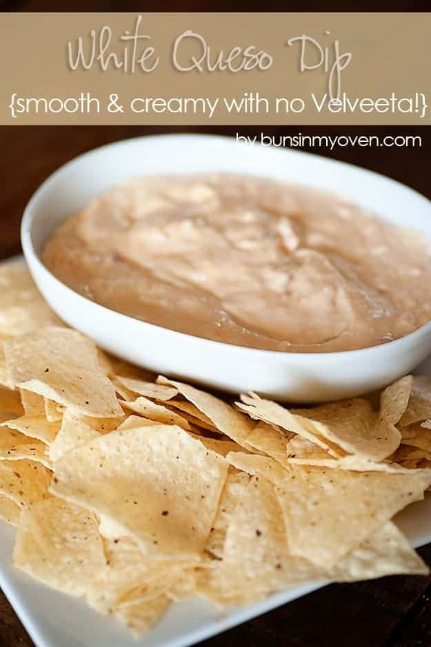 creamy queso dip in a white bowl next to a bunch of chips.