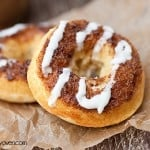 A close up of two cinnamon roll donuts