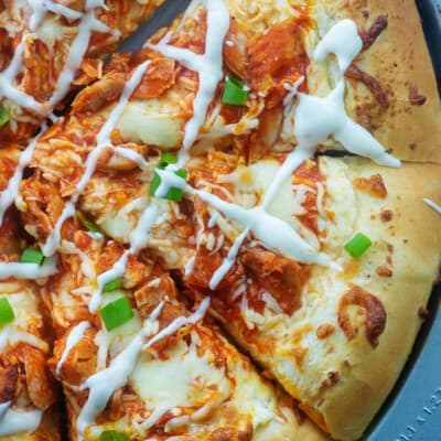 overhead view of sliced buffalo chicken pizza.