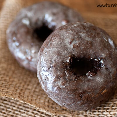A close up of a chocolate doughnut