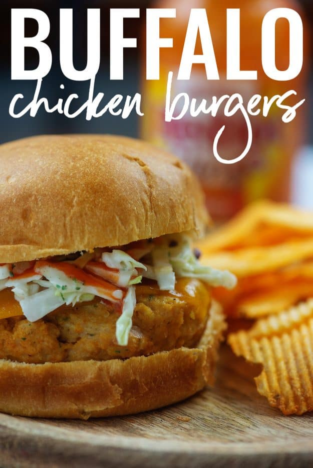 buffalo chicken burgers on cutting board with chips