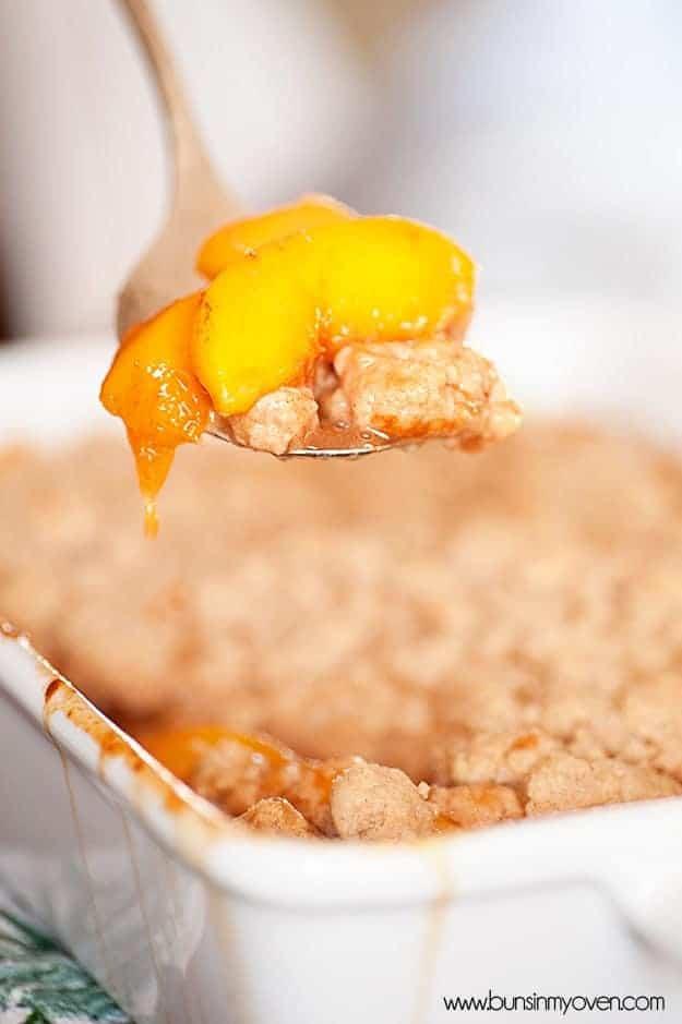 A spoonful of peach cobbler.