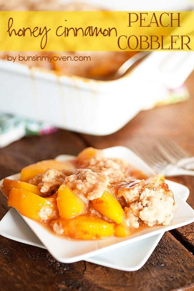 A close up of peach cobbler on a white plate.