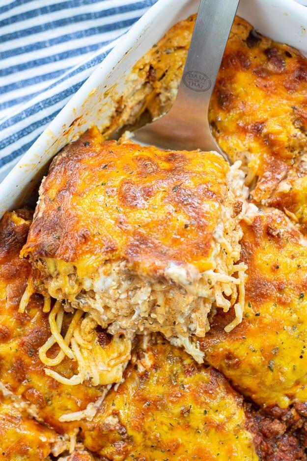 creamy baked spaghetti in baking dish.