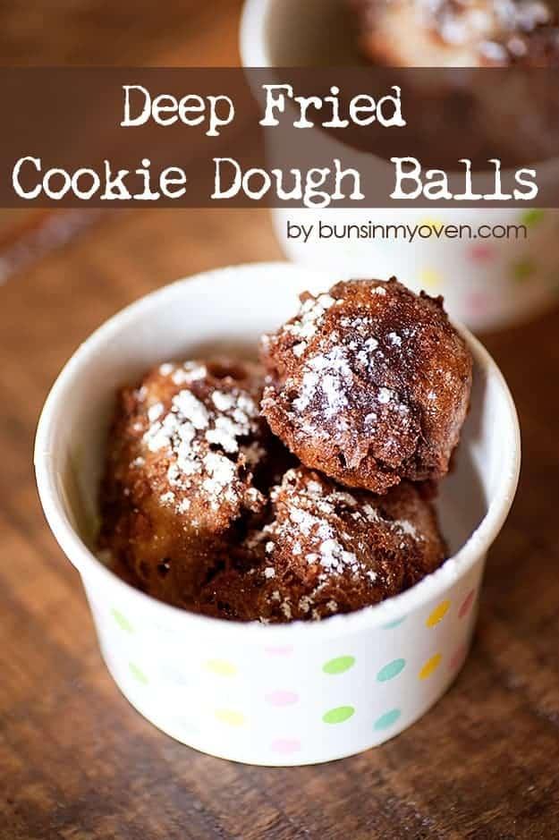 A closeup of fried cookie dough balls in a paper cup