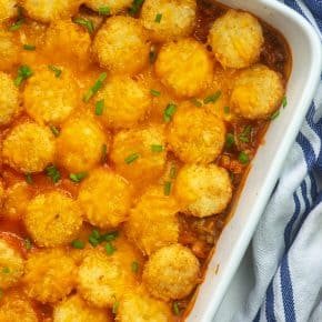 tater tot casserole in white dish.