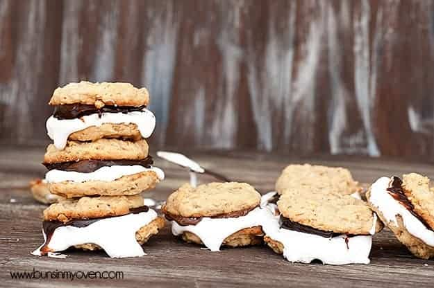 Several smores sandwich cookies on a table.