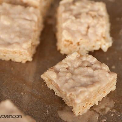 Some small rice crispy treats on a baking sheet.
