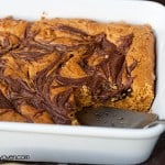 A white baking pan with cooked pumpkin bars in it.