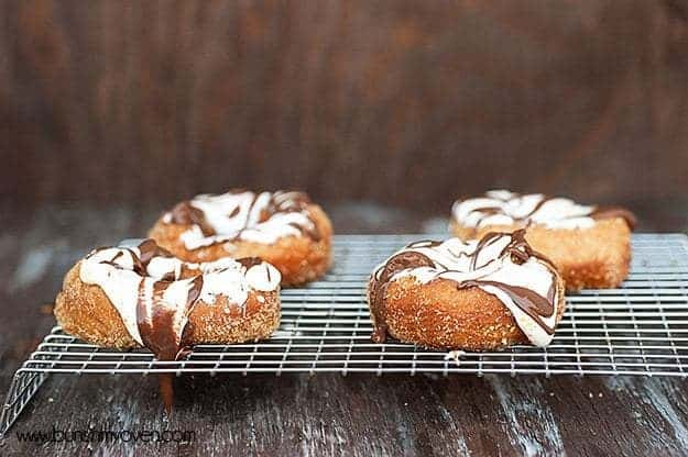 four smores doughnuts on a wire cooling rack.