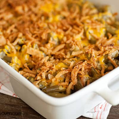 A white baking dish full of green bean casserole.