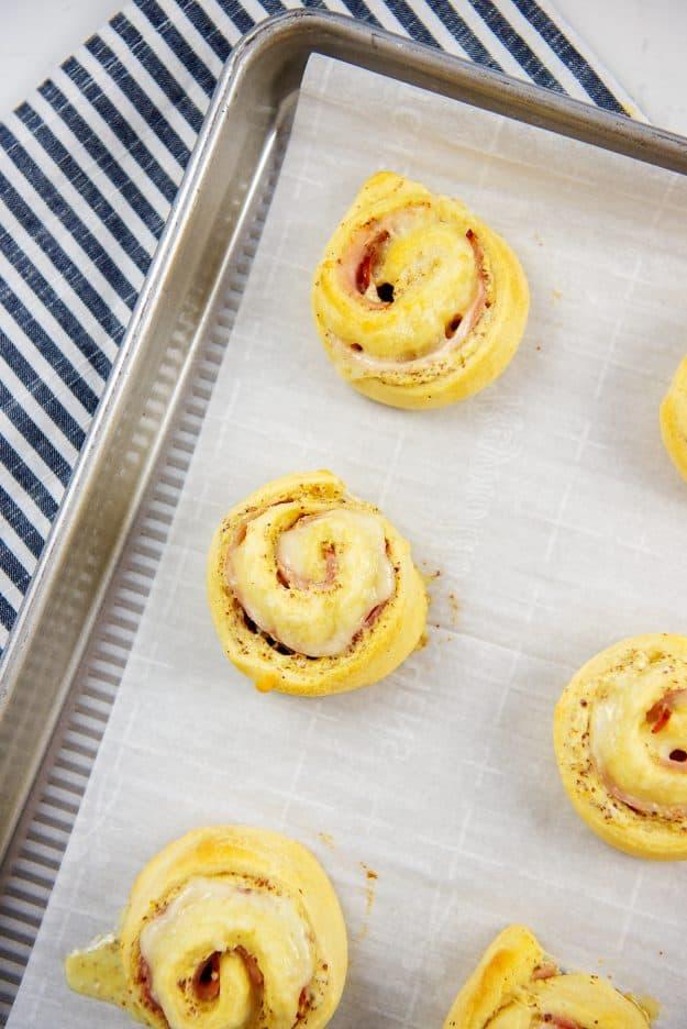 ham and swiss pinwheels on baking sheet.
