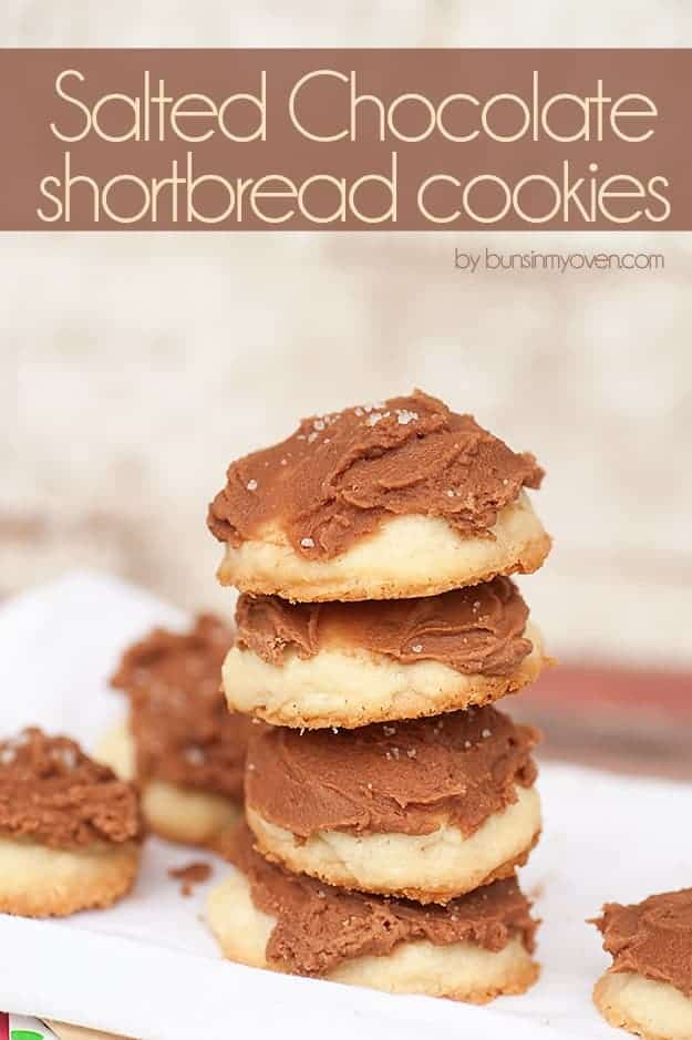 A stack of chocolate frosted shortbread cookies.