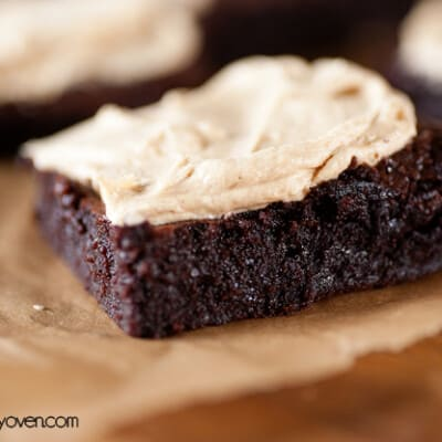 A close up of a peanut butter frosted brownie.