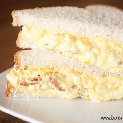A triangle cut egg salad sandwich.