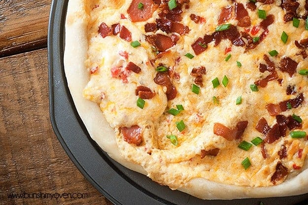 Overhead view of cheesy bacon pizza.