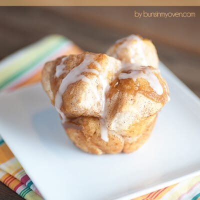 A monkey bread muffin on a square white plate.