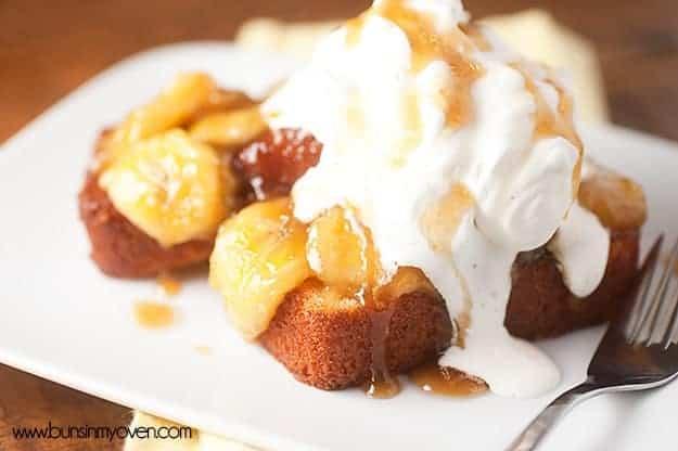 A caramelized banana pound cake on a white plate.