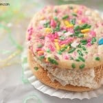 A close up of a sprinkled ice cream sandwich