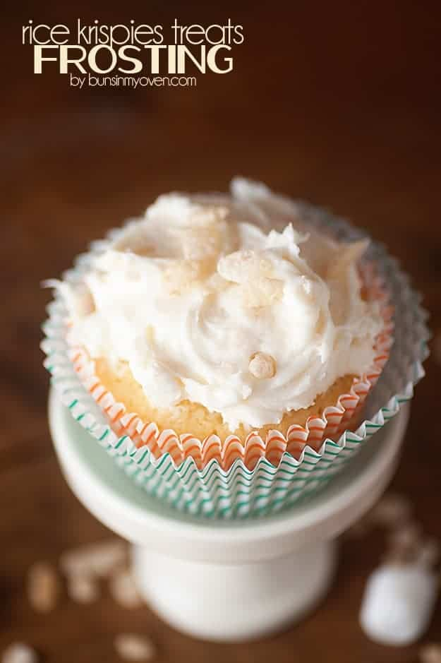 An overhead view of a decorated cupcake on a white cupcake stand.