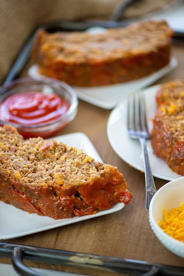 bacon cheeseburger meatloaf on white plates.