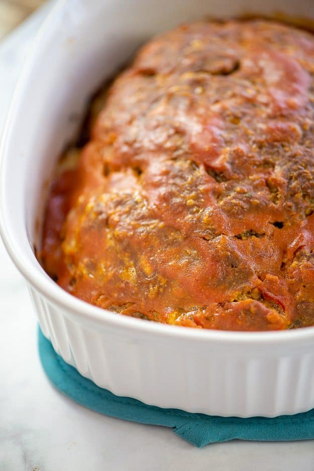 bacon cheeseburger meatloaf in white baking dish.