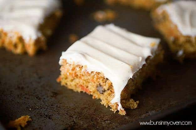 A piece of carrot cake topped with cream cheese frosting.