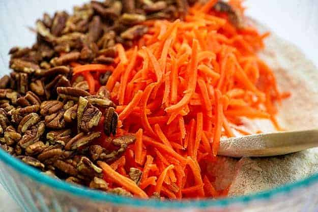 ingredients for carrot cake bars in glass bowl