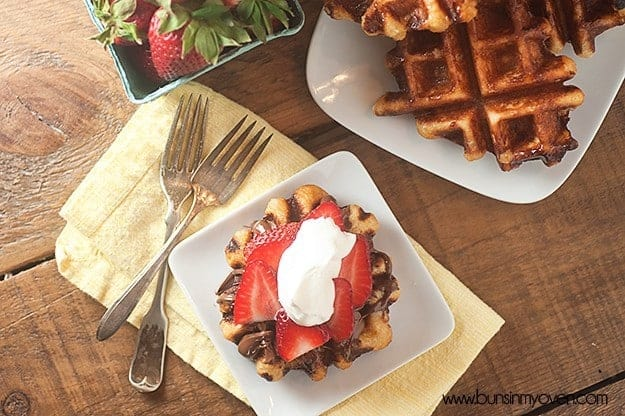 Loaded with chunks of sugar, these liege waffles are SO not your typical breakfast waffle!  Topped with Nutella and strawberries!