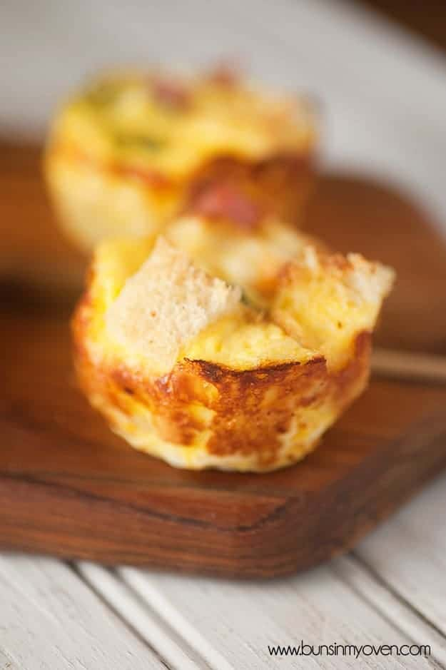 A close up of a ham and cheese strata on a cutting board.