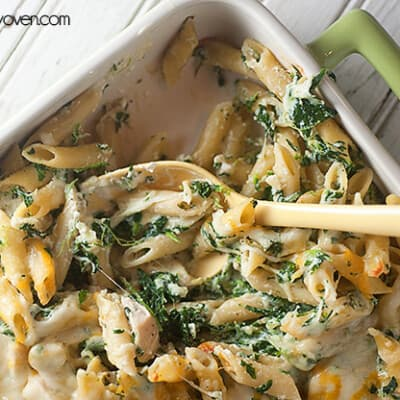 Pasta and spinach artichoke dip in a nine by thirteen baking dish