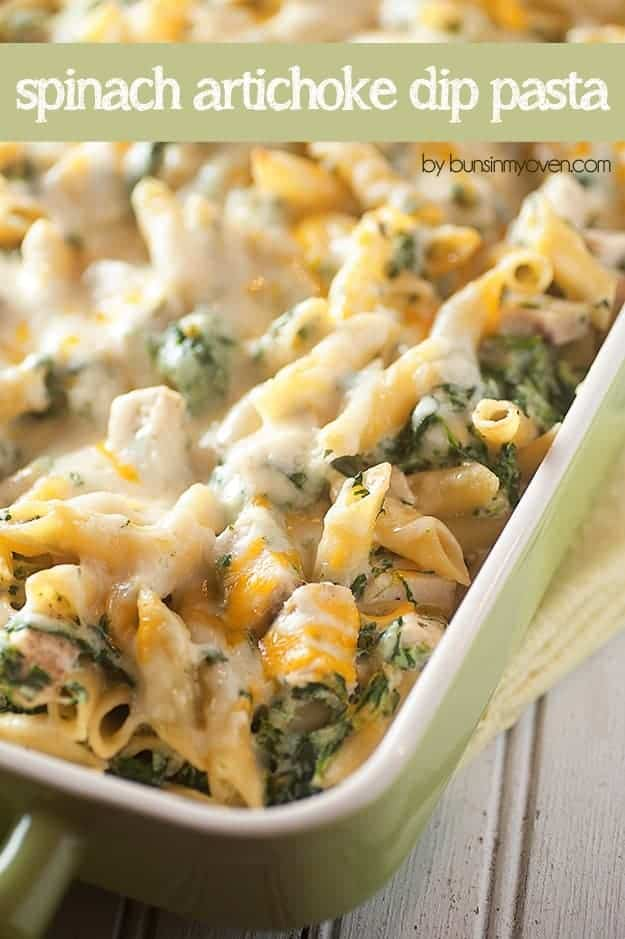 Overhead view of cheesy chicken artichoke dip pasta in a baking pan.