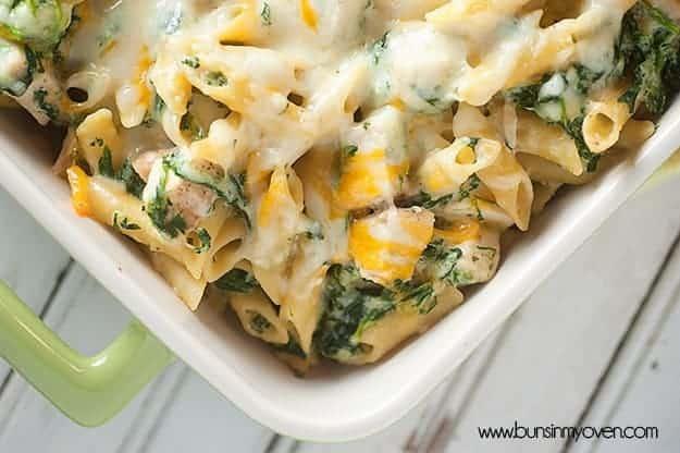 Spinach artichoke dip pasta in a baking dish.
