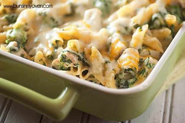A baking dish with cheesy spinach pasta.